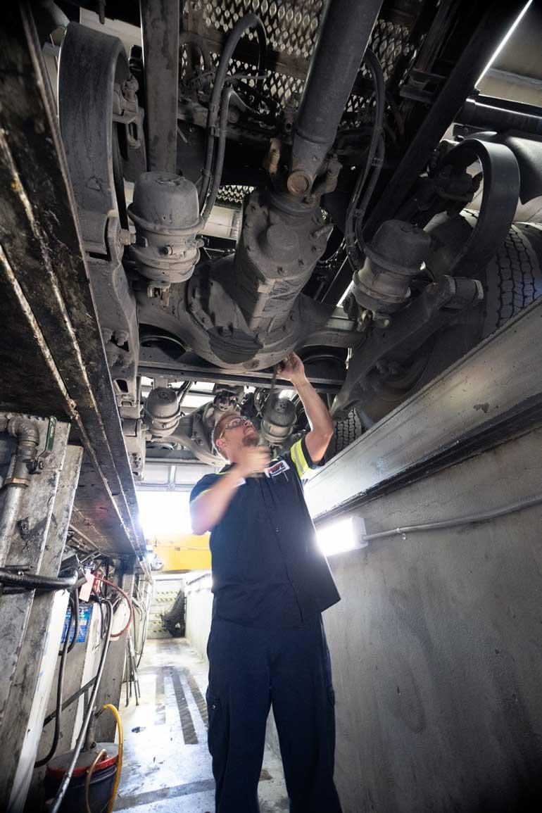 a diesel mechanic works on a semi truck