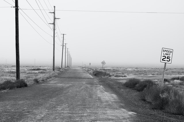 black and white dirt road and 35mph speed sign