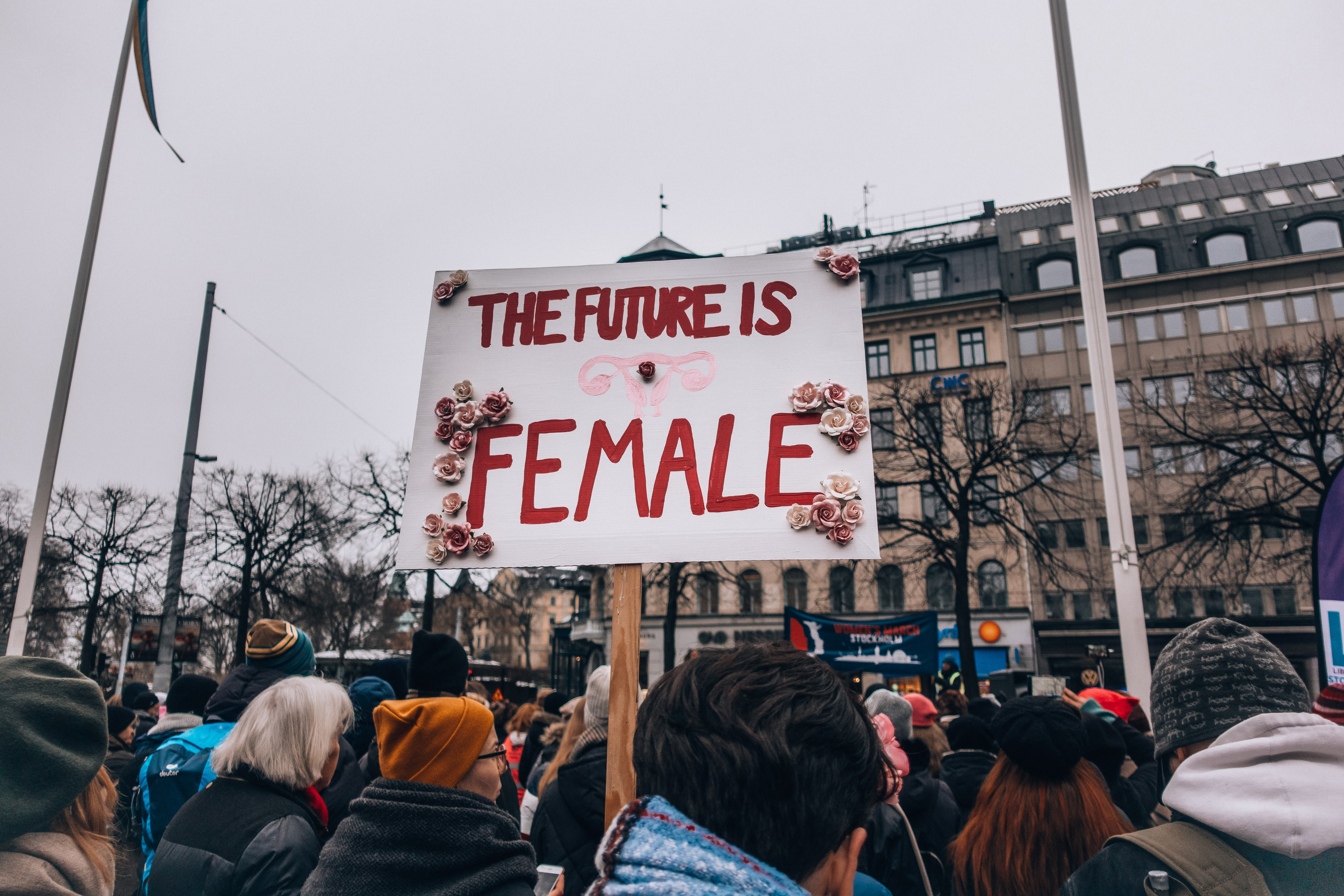 womens march participant holding a sign reading the future is female
