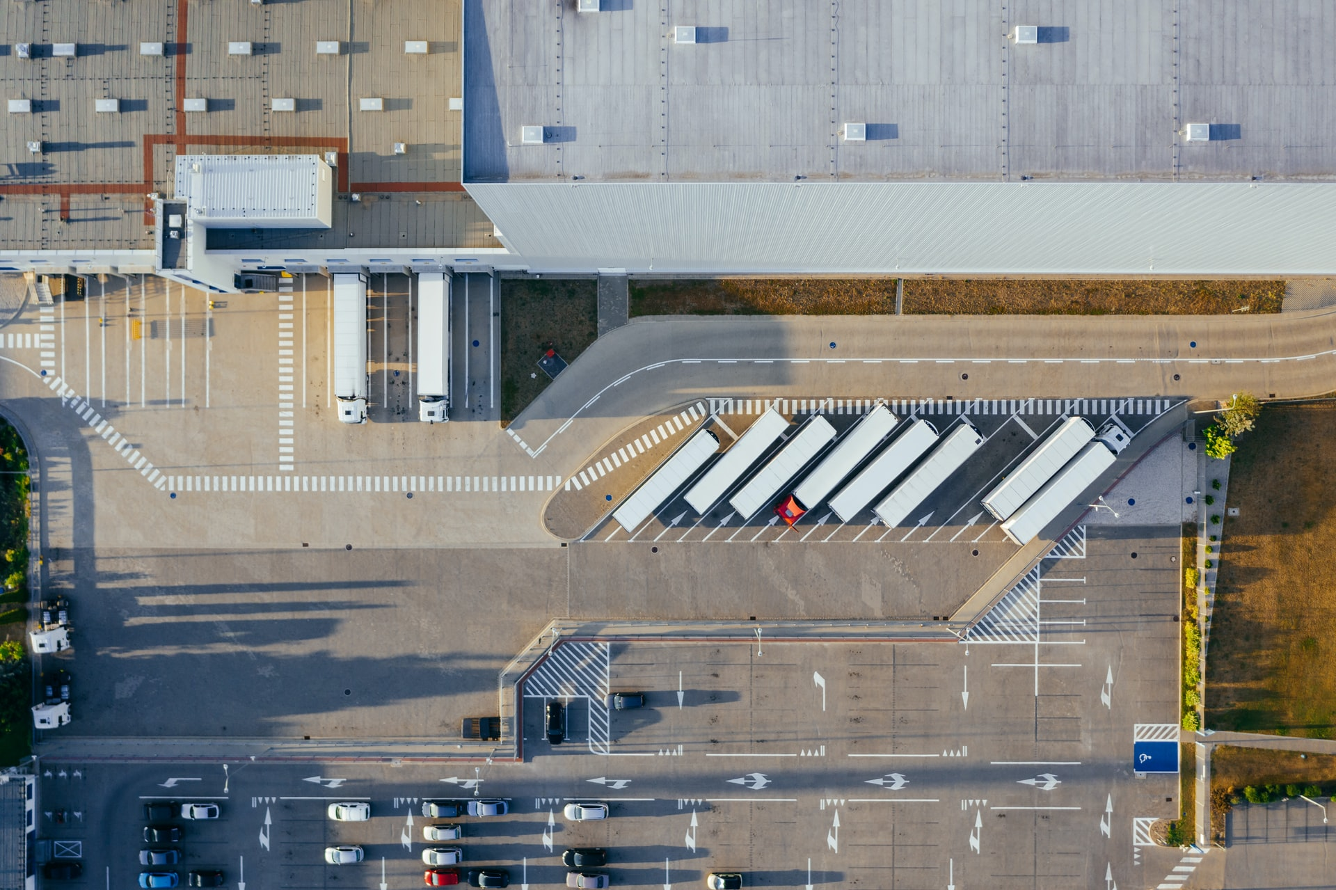 ariel view of trucks dropping off goods at warehouse