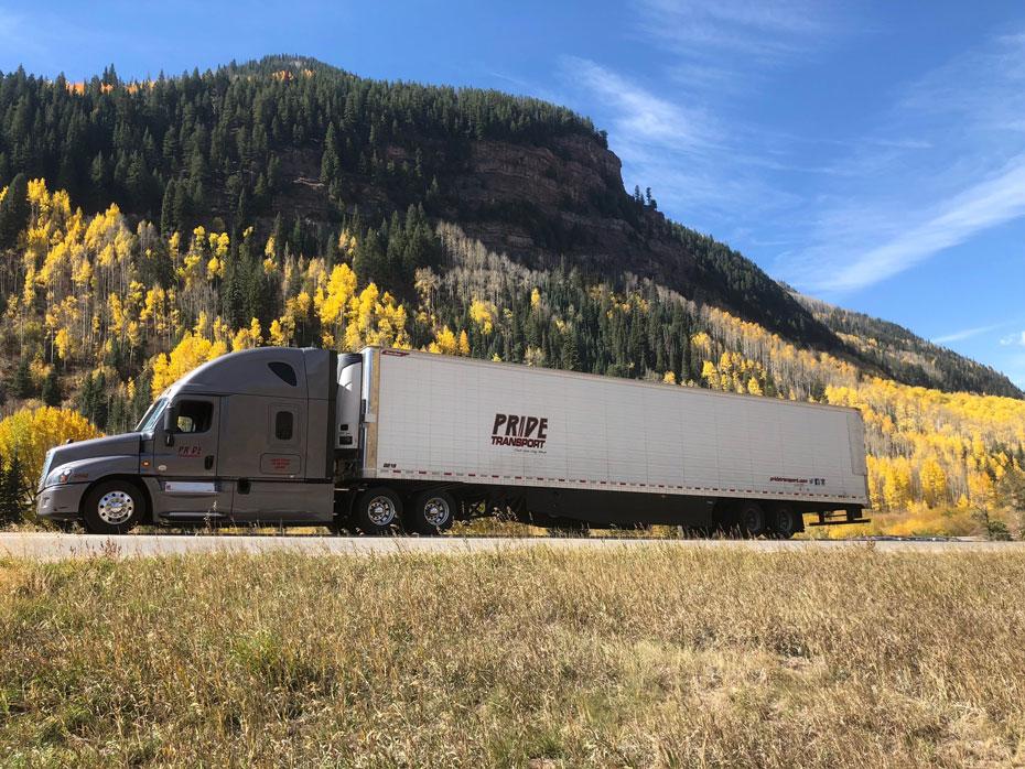 long haul truck driving through a canyon